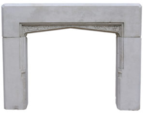 An Antique English Gothic Style Stone Fireplace