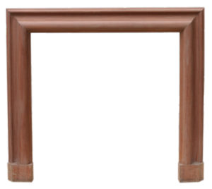 An Antique Bolection Style Mahogany Fire Surround