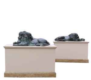 A Pair of Bronze Lions in The Manner of Antonio Canova