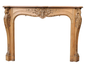 An Antique English Carved Oak Fire Surround
