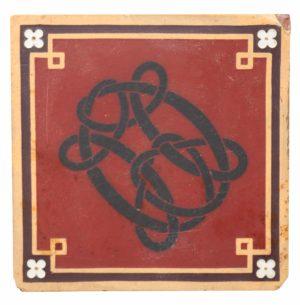 An Antique Monogrammed Minton Encaustic Tile