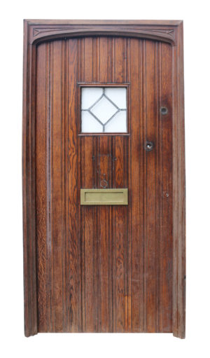 A Reclaimed Arched Oak Exterior Door with Frame