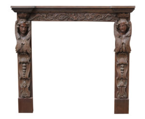 An Antique Carved Oak Fire Surround