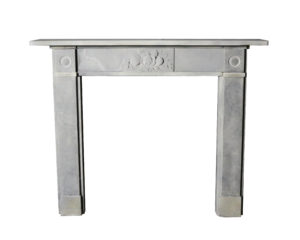 An Antique Carved Stone 'Bullseye' Fire Surround