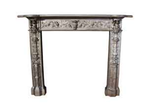 An Antique Cast Iron Fire Surround in The Renaissance Revival Manner