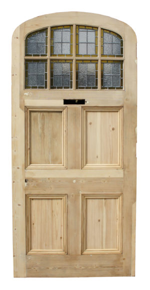A Large Reclaimed Arched Front Door with Stained Glass