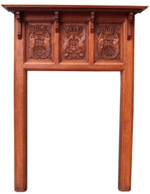 An Antique Carved Oak Fireplace