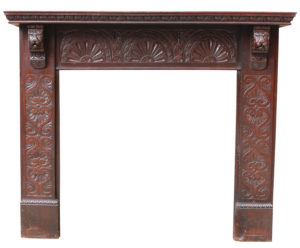 An Antique Jacobean Style Carved Oak Fire Surround