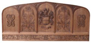 An Antique Carved Oak Over-mantle or Headboard