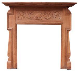 An Antique Art Nouveau Oak Fireplace Surround