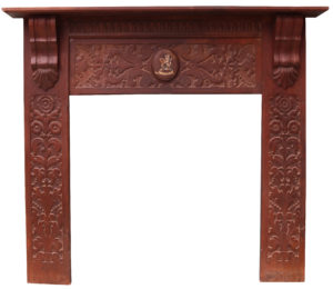 An Antique Jacobean Style Carved Oak Fireplace