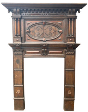 A Tall Jacobean Period Carved Oak Fireplace Surround