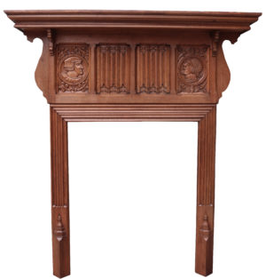 An Antique Jacobean Revival Carved Oak Fireplace