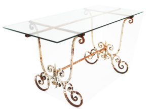 A Reclaimed Glass and Wrought Iron Garden Table