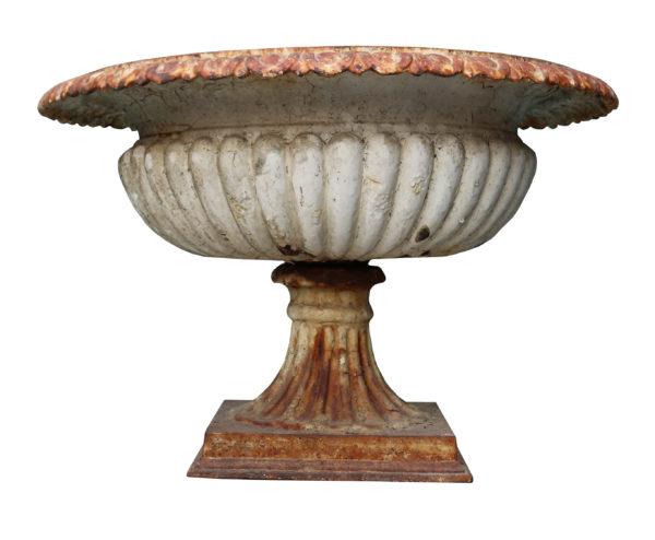A reclaimed shallow cast iron 'tazza' style garden urn.