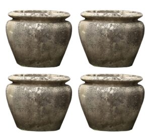 A Set of Four Reclaimed Weathered Stone Planters
