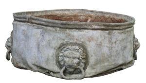 An Antique Circular Lead Planter with Lion Masks