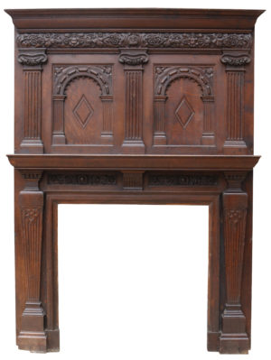 An Antique English Jacobean Style Fireplace