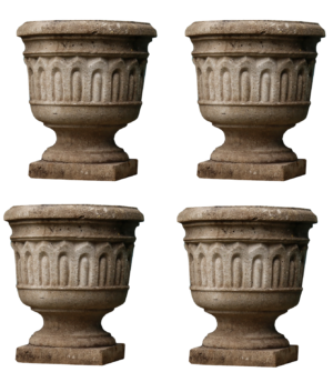 A Set of Four Reclaimed Composition Stone Planters