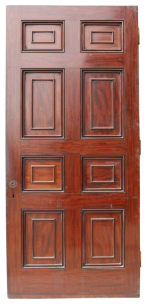 A tall Georgian style, eight panel door veneered with mahogany.