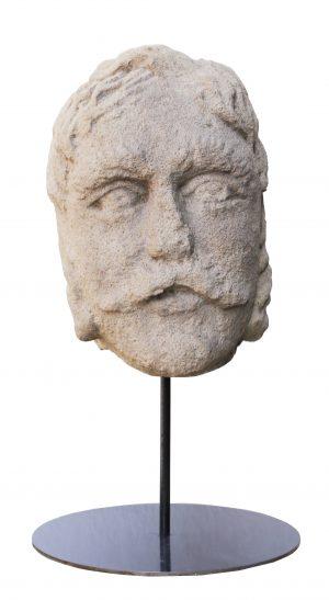 An 18th Century English Carved York Stone Head